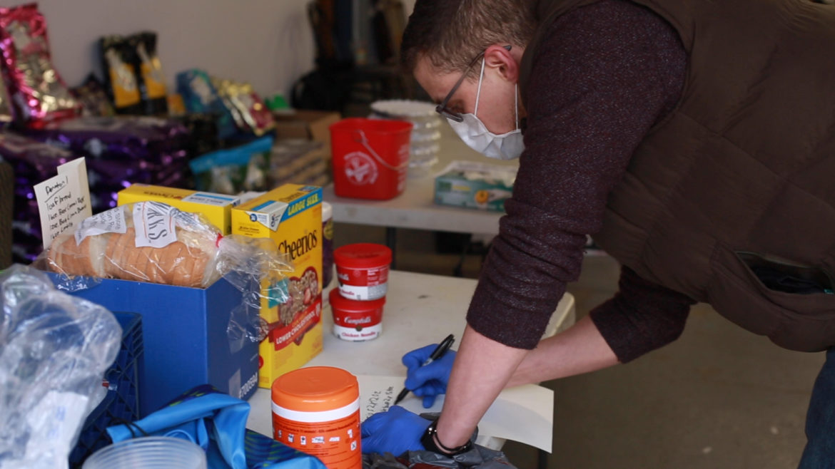 Tim Kratt, a volunteer for Pittsburgh Restaurant Workers Aid, takes stock of distributions in the group's donated space at The Irma Freeman Center. (Photo by Hali Tauxe/Courtesy of Pittsburgh Restaurant Workers Aid)