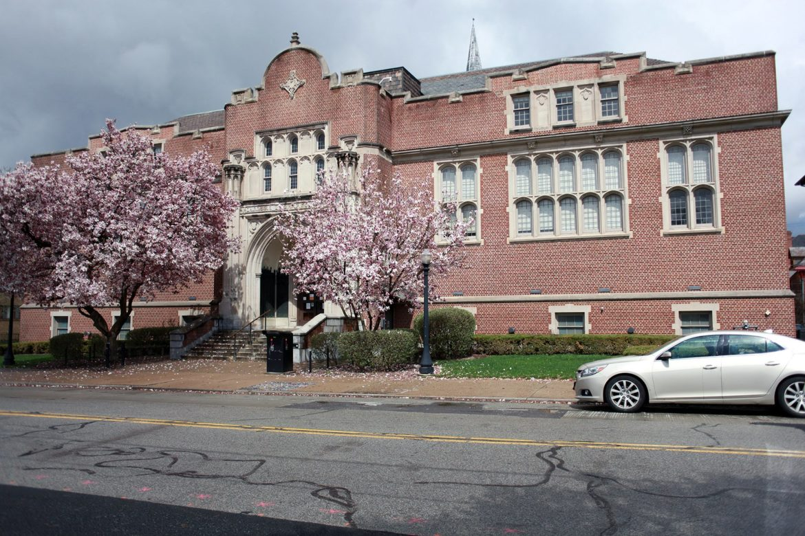 A car sits parked in front of the Homewood branch of the Carnegie Library on April 1. (Photo by Kimberly Rowen/PublicSource)