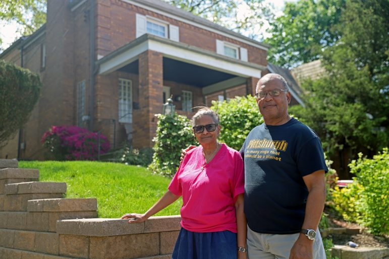 Gail and Leroy Payne stand in front of their Stanton Heights home. One of their two daughters, and one granddaughter, live with them. But their other daughter moved out of the neighborhood, as have many Black and young residents in the last decade. (Photo by Jay Manning/PublicSource)
