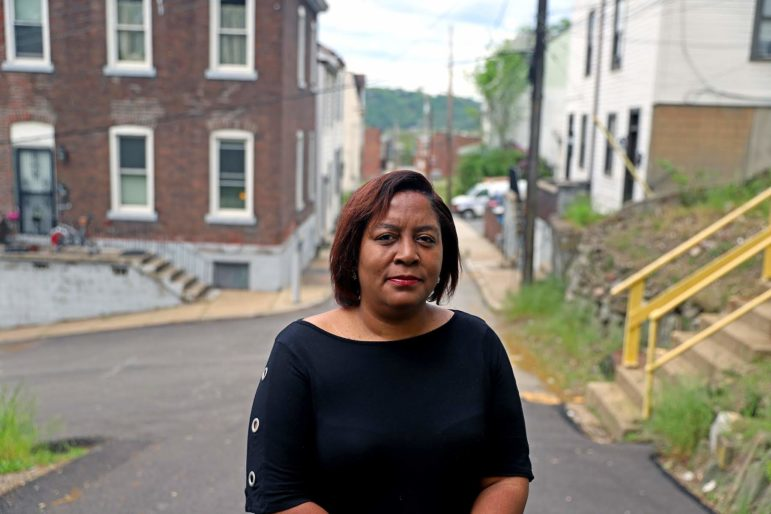 Dalena Wallace lives in a rowhouse in California-Kirkbride. The neighborhood saw its Black population drop by about a third over the last decade, a rate of decline that's twice as fast as its small white population. (Photo by Jay Manning/PublicSource)