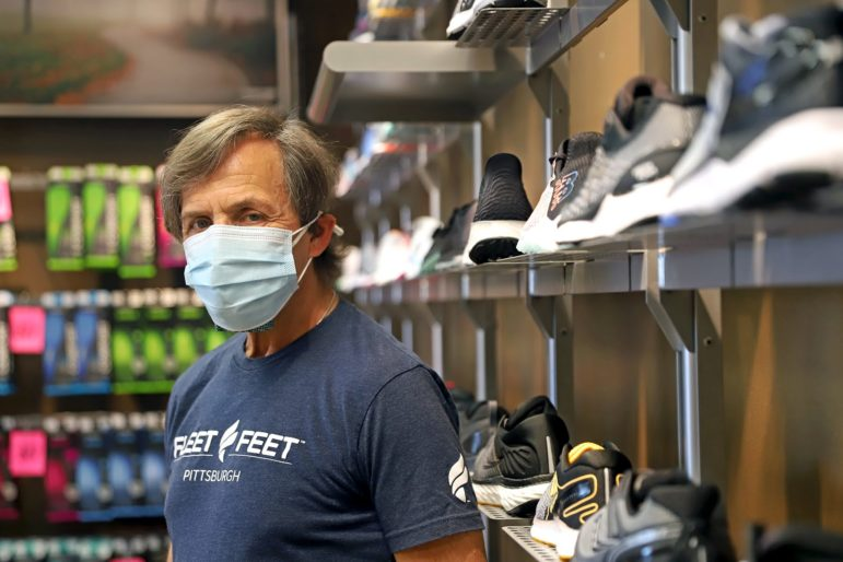 Bob Shooer lost 14 pounds during Fleet Feet's two month hiatus, his longest break from retail work. (Photo by Jay Manning/PublicSource)