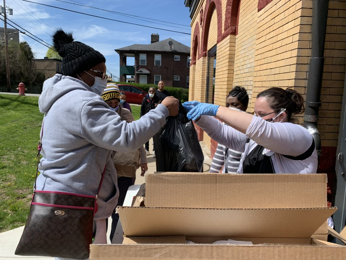 Residents receive provisions and census information at Paulson Recreation Center in Lincoln-Lemington-Belmar. (Courtesy photo from Josiah Gilliam/City of Pittsburgh)