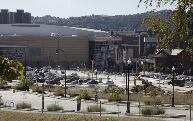 "Lower Hill District parking lots, north of PPG Paints Arena. ""The Penguins are needed,"" said URA board member Jodi Hirsh. ""Otherwise we're staring at a parking lot for 10 years and a community that continues to be starved of resources."" (Photo by Ryan Loew/PublicSource)"