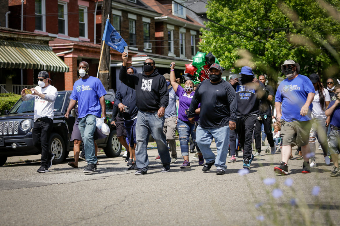 Pennsylvania State Rep. Ed Gainey marching through Homewood protesting against violence in the community on Saturday, June 13. (Photo by Nick Childers/PublicSource)