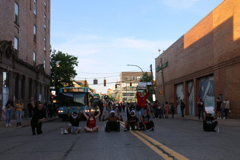 While many protesters have dispersed into adjoining streets, a crowd waited by Whole Foods on Center Avenue. (Photo by Alexis Lai/PublicSource)