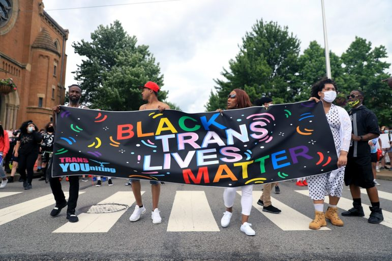 A banner supporting Black transgender rights at the head of a June 18, 2020 march from the Hill District through downtown Pittsburgh. (Photo by Jay Manning/PublicSource)