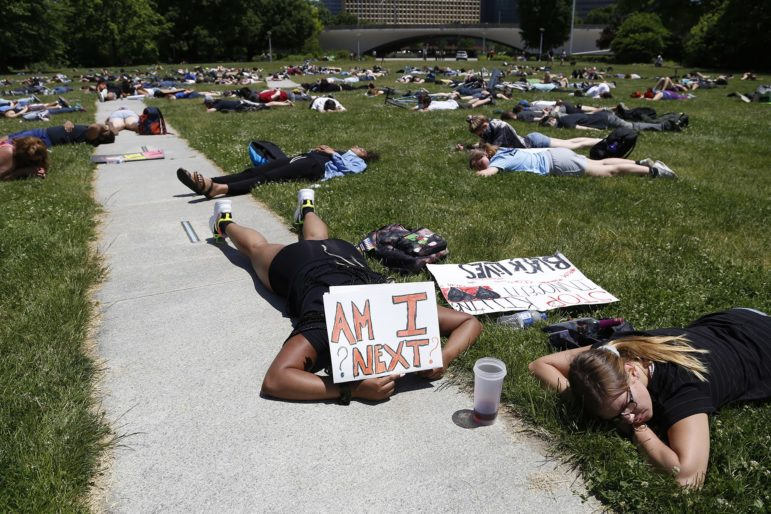 Hundreds of people lie on the ground in silence at Point State Park Sunday for eight minutes and 46 seconds, the amount of time prosecutors say a white Minneapolis police officer had his knee on George Floyd's neck before he died. (Photo by Ryan Loew/PublicSource)