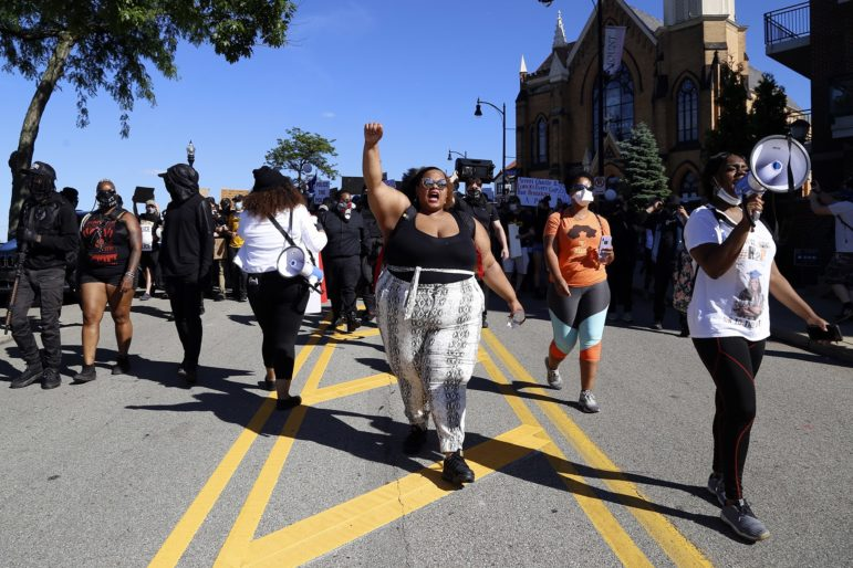 Dasia Clemons (center), organizer of Sunday's march and founder of the group Pittsburgh I Can't Breath, marches down Grandview Avenue in Mount Washington. (Photo by Ryan Loew/PublicSource)