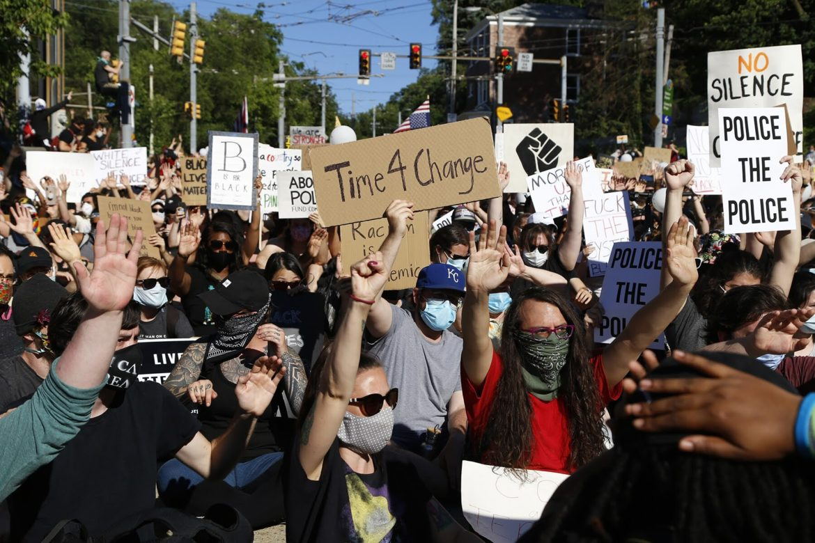 Protesters pause on Arlington Avenue en route to Downtown Pittsburgh in June 2020. (Photo by Ryan Loew/PublicSource)