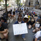 Protesters kneel in front of the Allegheny County Courthouse (Photo by Ryan Loew/PublicSource)