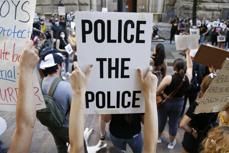 Demonstrators rally in front of the Allegheny County Courthouse on June 8 to protest police brutality and racial inequities in the criminal justice system. (Photo by Ryan Loew/PublicSource)