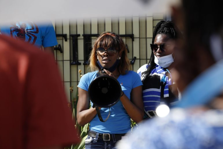 Arialynn Copeland (center), a friend of Aaliyah Johnson, speaks to rally-goers outside the McKeesport Public Safety Building on Friday alongside event co-organizer Dena Stanley. (Photo by Ryan Loew/PublicSource)