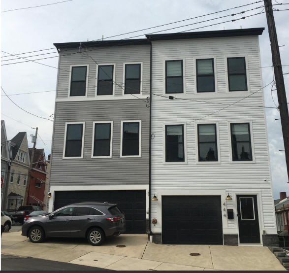 """An example of the kind of front-yard driveway-and-garage design that would be strongly discouraged under """"parking reform"""" approved by the City Planning Commission on Feb. 23, 2021."""