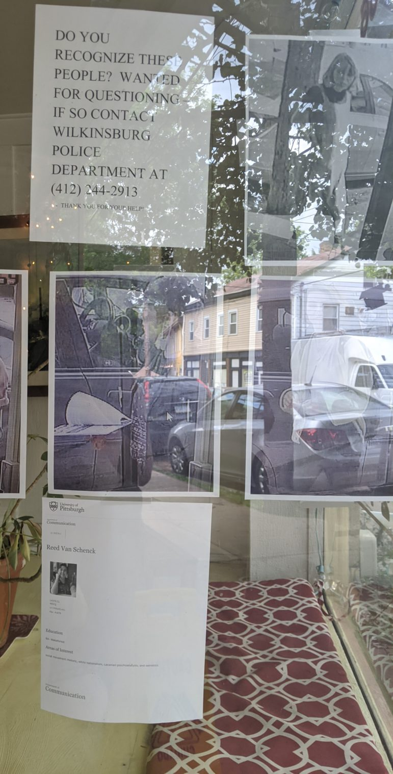 The windows of C.P. Development's office in Wilkinsburg, on June 3, included pictures of four people (one of whom has been cropped out at the person's request), Reed Van Schenck's profile from the University of Pittsburgh's website, and a claim that they were wanted for questioning by the Wilkinsburg police. (Courtesy of Reed Van Schenck)