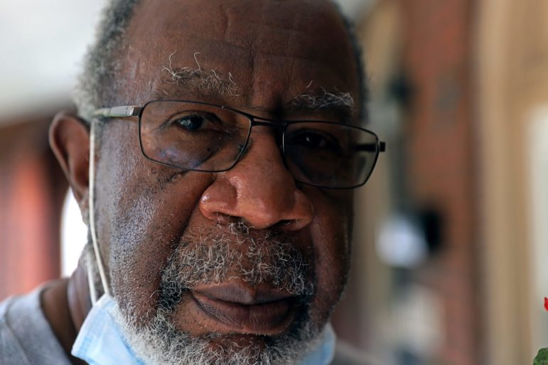 George Moses in front of his home in Point Breeze (Photo by Jay Manning/PublicSource)