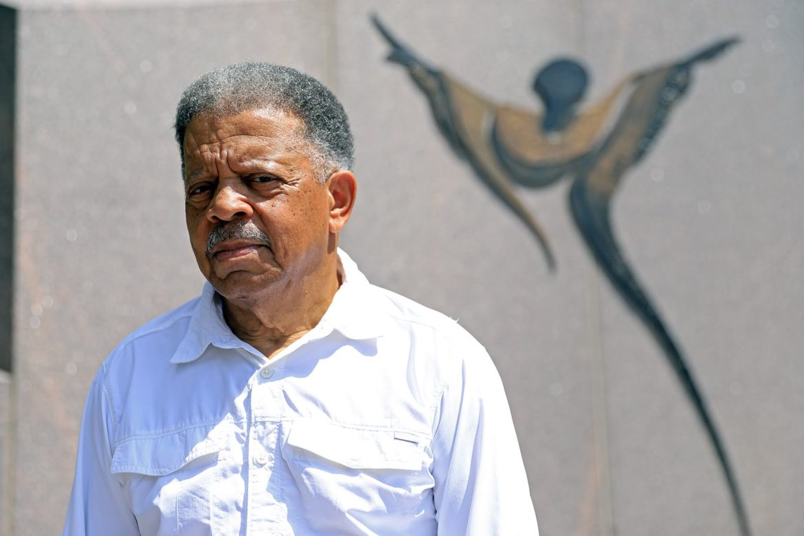 Carlos Peterson stands at Freedom Corner. (Photo by Jay Manning/PublicSource)