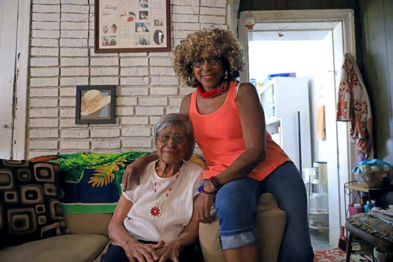 Brenda Tate (right) and Margaret Watson, who is turning 100 on July 5, at Brenda Tate's home in the Hill District (Photo by Jay Manning/PublicSource)