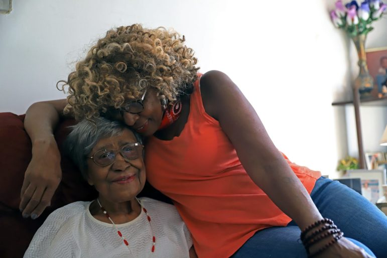 Brenda Tate (right) and her aunt Margaret Watson, who turns 100 on July 6, at Brenda Tate's home in the Hill District (Photo by Jay Manning/PublicSource)