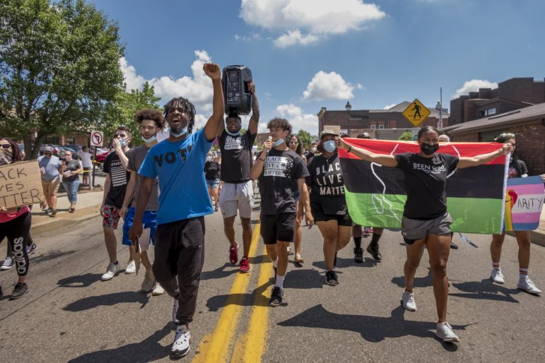 Zheire Patmon, front left, and other demonstrators march in Canonsburg during a June 20, 2020 protest. (Photo by Heather Mull/PublicSource)