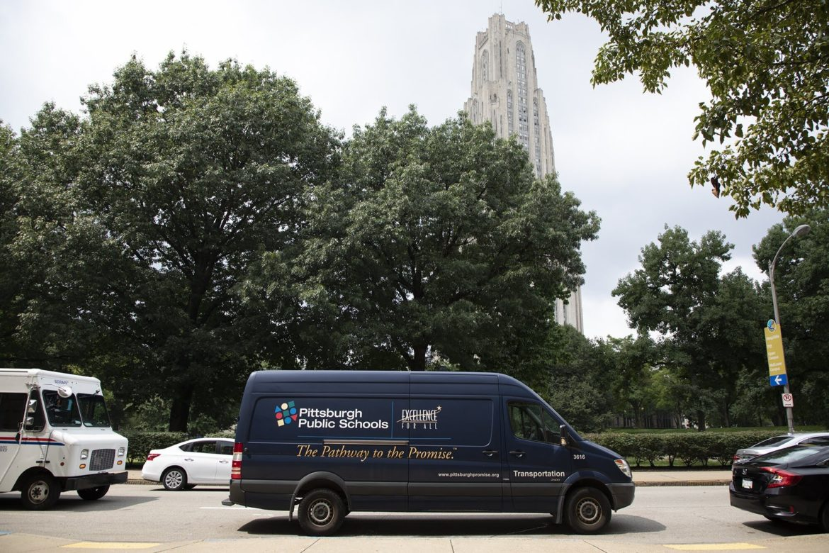 A Pittsburgh Public Schools transportation van parked outside the district's administrative building in Oakland in August 2018. (Photo by Kat Procyk/PublicSource)