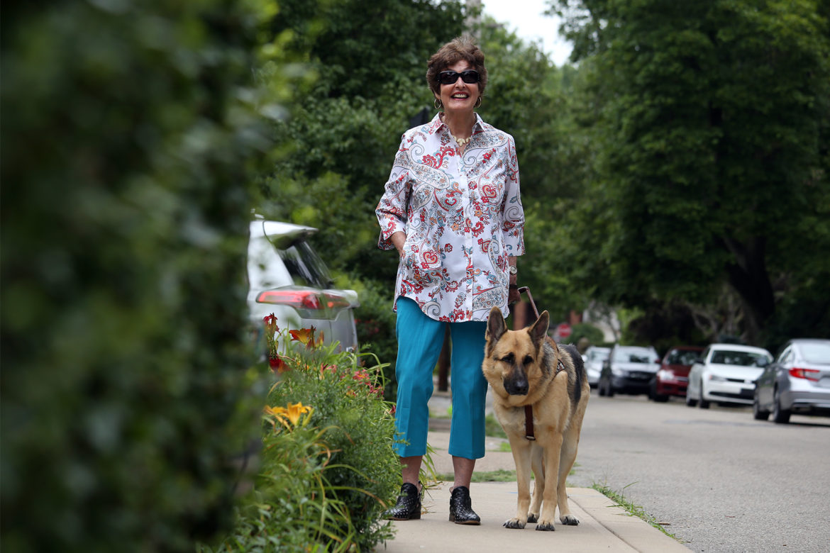 Sally Hobart Alexander with her guide dog, Dave. (Photo by Ryan Loew/PublicSource)