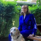Catherine Getchell and her guide dog in her backyard in Squirrel Hill. (Photo by Jay Manning/PublicSource)