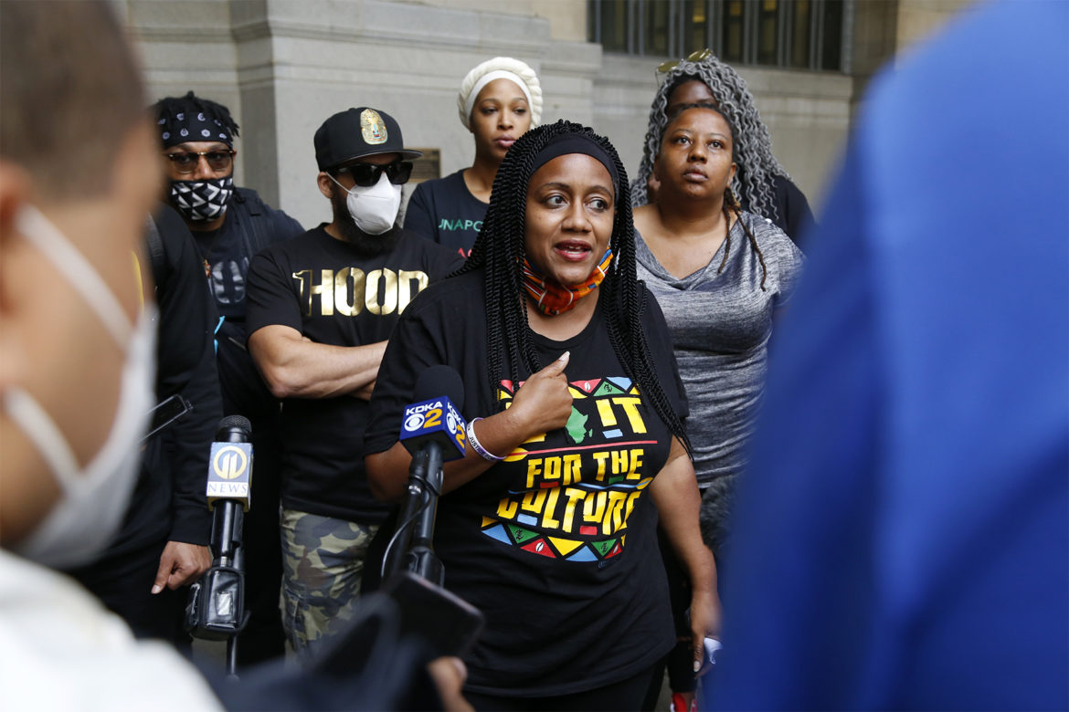 Fawn Walker-Montgomery, a member of The Allegheny County Black Activist/Organizer Collective and co-founder of Take Action Mon Valley, addresses the crowd gathered at the City-County Building in Downtown on June 15.