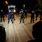 Line of police officers in riot gear