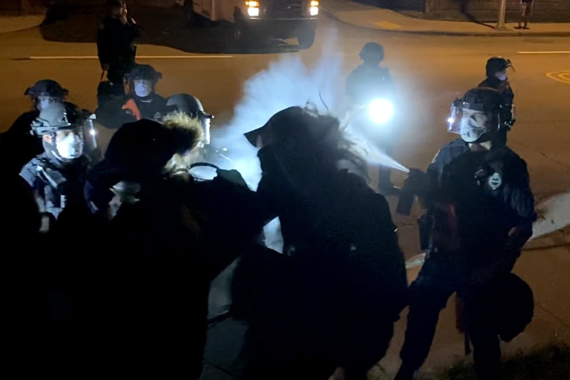 Police sprays eye irritant into protester face