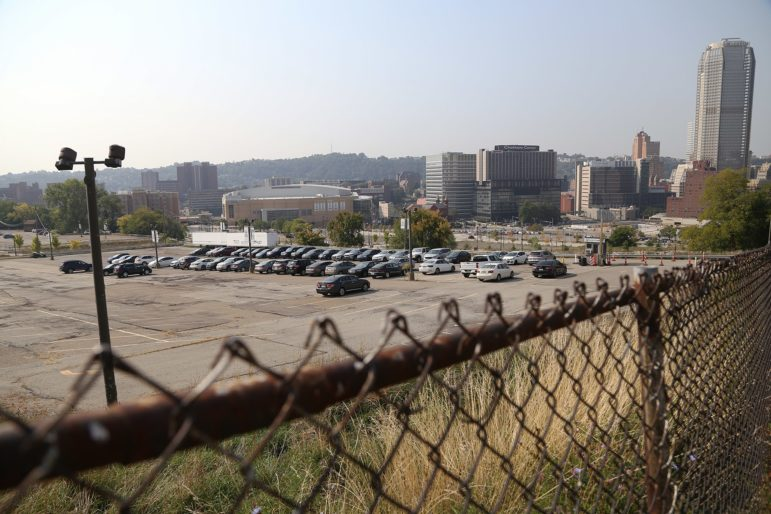 Now a parking lot, the future of the 28-acre site of the former Civic Arena continues to be a bone of contention between the Pittsburgh Penguins' development team, and the Hill Community Development Corp. (Photo by Ryan Loew/PublicSource)