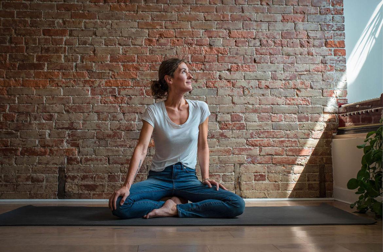 Megan Flinn in her yoga studio in Penn Avenue in Garfield. (Photo by Teake Zuidema/PublicSource)