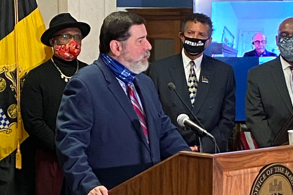 Pittsburgh Mayor Bill Peduto (center) stands with two members of his Pittsburgh Community Task Force for Police Reform, Richard Garland (left) and Tim Stevens, at the unveiling on Oct. 19, 2020, of the panel's report, at the City-County Building, Downtown. (Photo by Rich Lord/PublicSource)