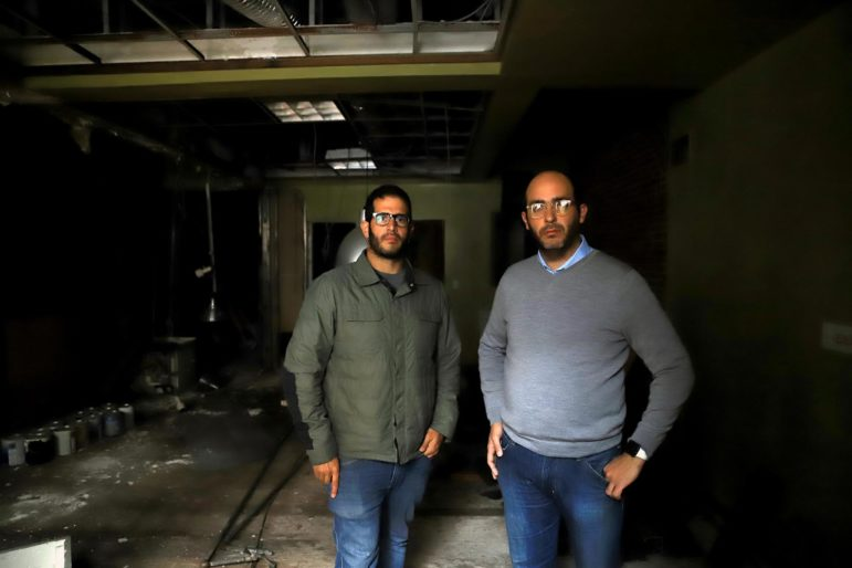 "Michael (right) and Nicholas (left) Troiani stand in one of their buildings in Downtown Pittsburgh's Firstside district. They say the buildings are held together with ""100-plus years of Band-Aids."" (photo by Jay Manning/PublicSource)"