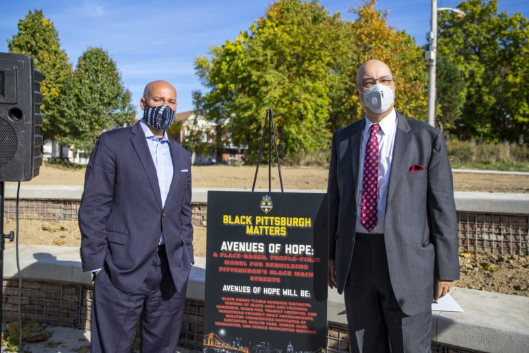 Pittsburgh City Council members R. Daniel Lavelle and Rev. Ricky Burgess (left to right) stand together at a press conference in Larimer on Oct. 14, 2020. The two were the minds behind the Avenues of Hope initiative. (Photo by Jay Manning/PublicSource)