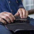 Richard McGann, a deafblind voter from Brookline, using a braille display that he connects to his phone,