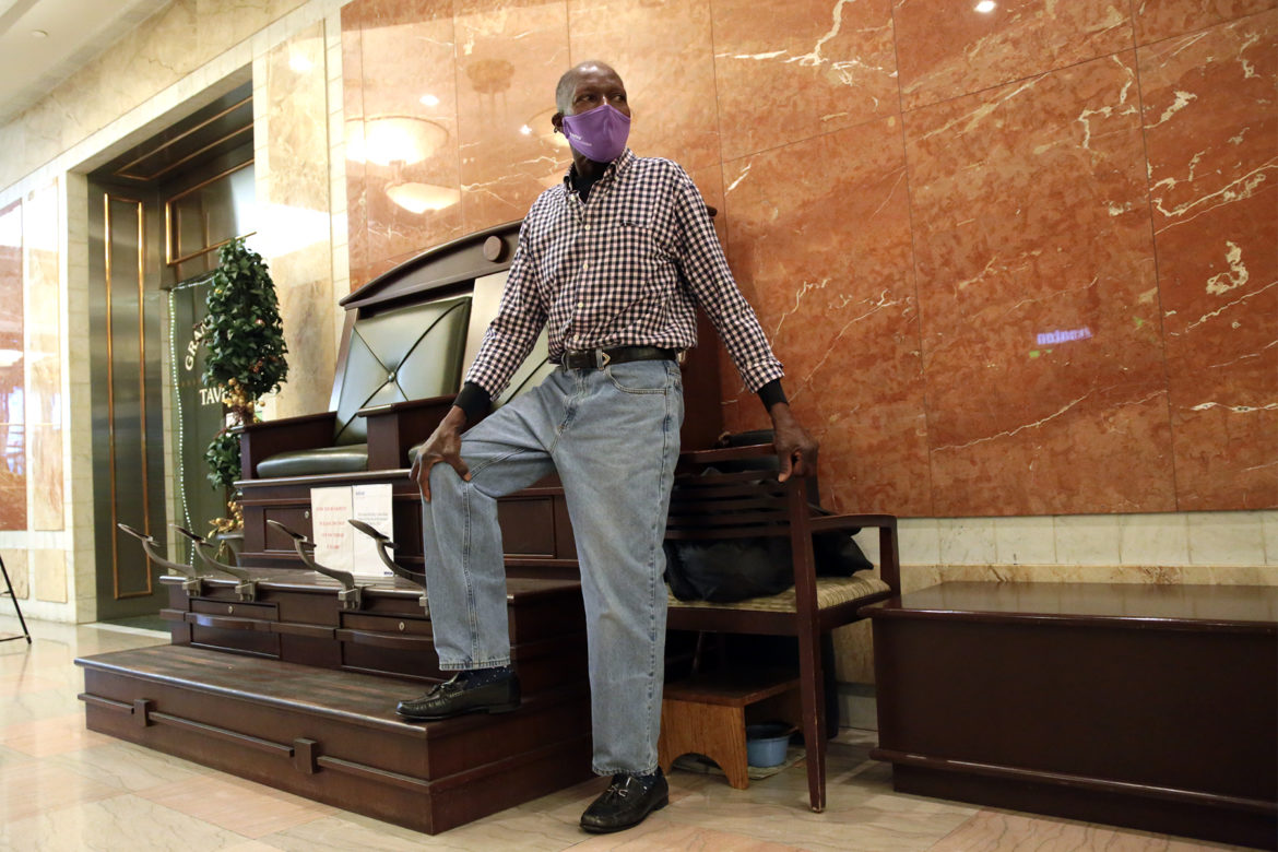 Arnie Newsome, 67, stands at his shoeshine station in the Grant Building. He is one of the few shoeshiners remaining Downtown. (Photo by Ryan Loew/PublicSource)