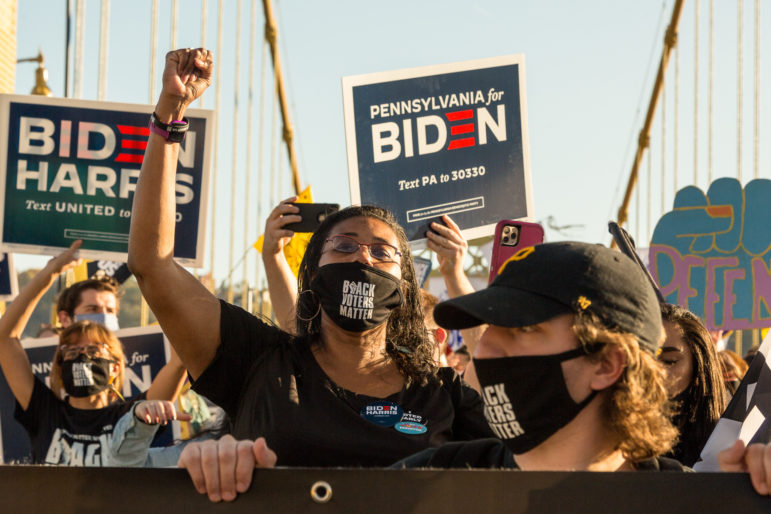Crowds march across the 10th Street Bridge in celebration of Joe Biden's victory on Nov. 7, 2020. (Photo by Nick Childers/PublicSource)