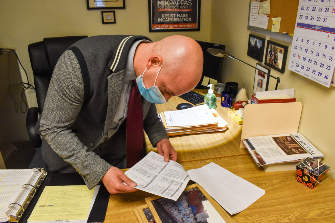 Judge Mik Pappas looks over a paper in his office.
