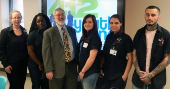 Marc Cherna with members of the DHS Youth Support Partners Team.