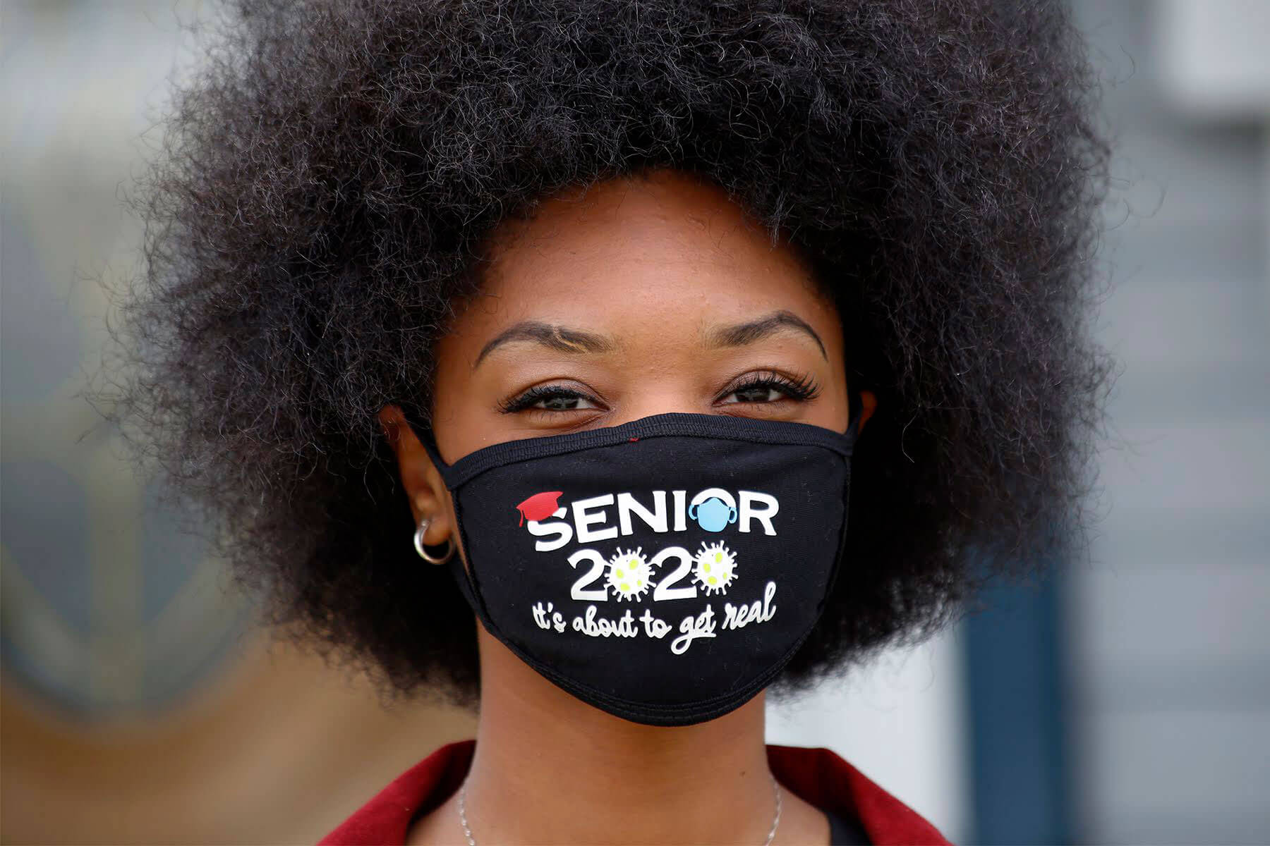 A person in a mask that says Senior 2020 It's About to Get Real.