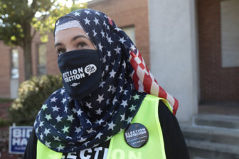 Christine Mohamed, executive director of CAIR Pittsburgh, wears a flag-themed headscarf. She is photographed outside a polling place on election day 2020.