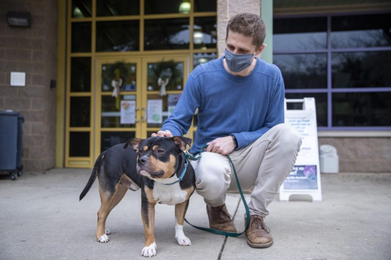 Cody Hoellerman with a dog from Animal Friends Shelter (photo by Jay Manning/PublicSource)