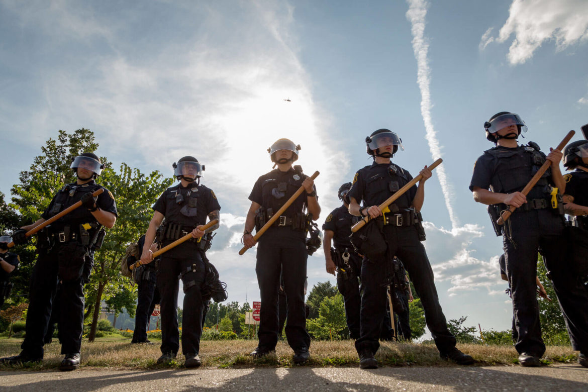 Pittsburgh Police in riot gear block Black Lives Matter protestors from walking up the Fort Pitt Bridge ramp on Saturday, July 4, 2020. (Photo by Nick Childers/PublicSource)