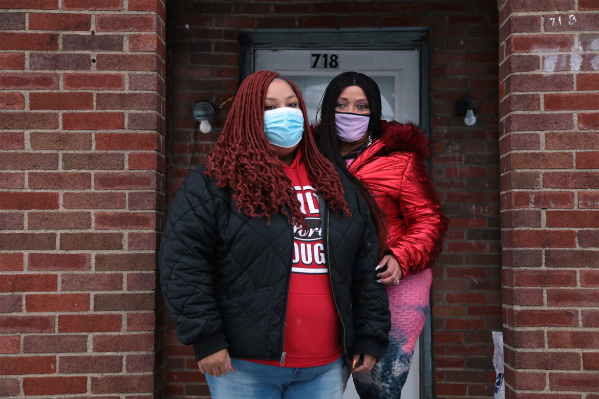 Brandi Cox, left, and her mother Nancy Cox-Gilmore stand in front of Nancy's house on Huey Street in McKeesport. (Photo by Ryan Loew/PublicSource)
