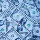 Stacked one dollar bills.