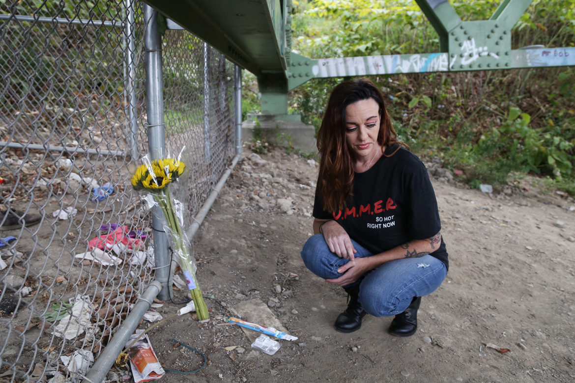 Rachel Kruze, 41, of Monaca, visits the site underneath P. J. McArdle Roadway on the South Side where her boyfriend overdosed and died. (Photo by Ryan Loew/PublicSource)