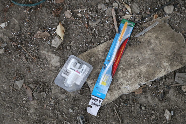 A dose of Narcan nasal spray and a toothbrush, seen near the site where Rachel Kruze's boyfriend overdosed and died. (Photo by Ryan Loew/PublicSource)