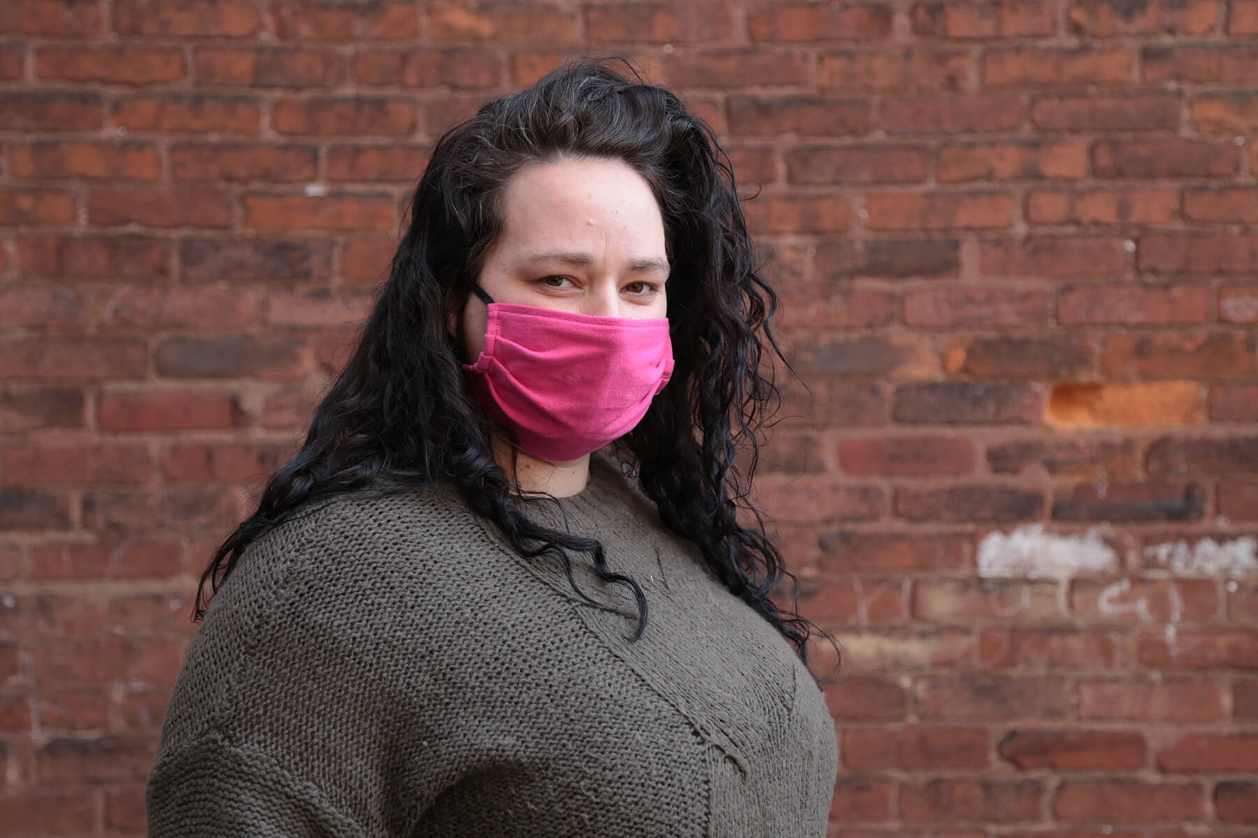 Amber J. photographed outside her home in January. (Photo by Ryan Loew/PublicSource)