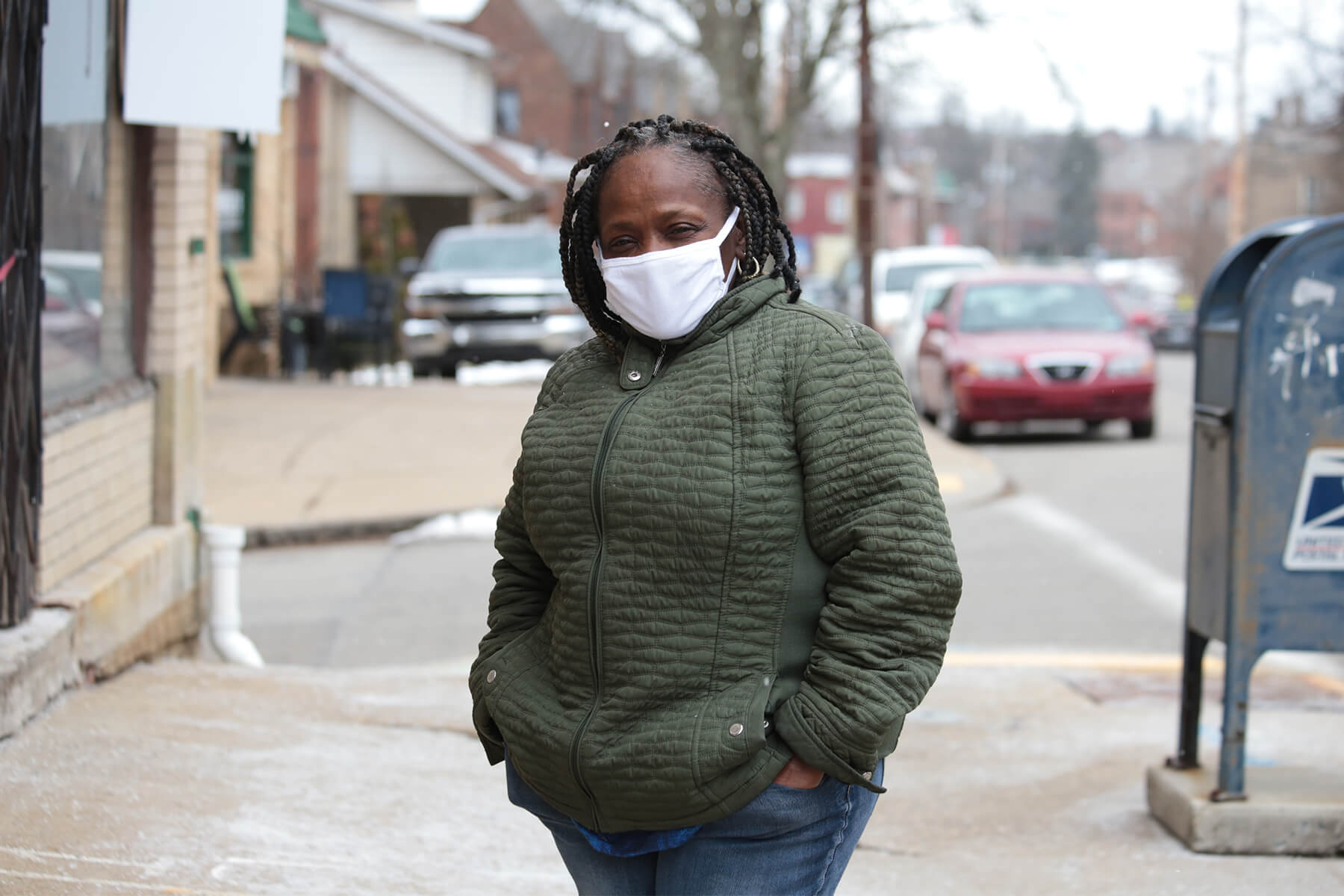 Laura W., outside her home in Carrick. (Photo by Ryan Loew/PublicSource)