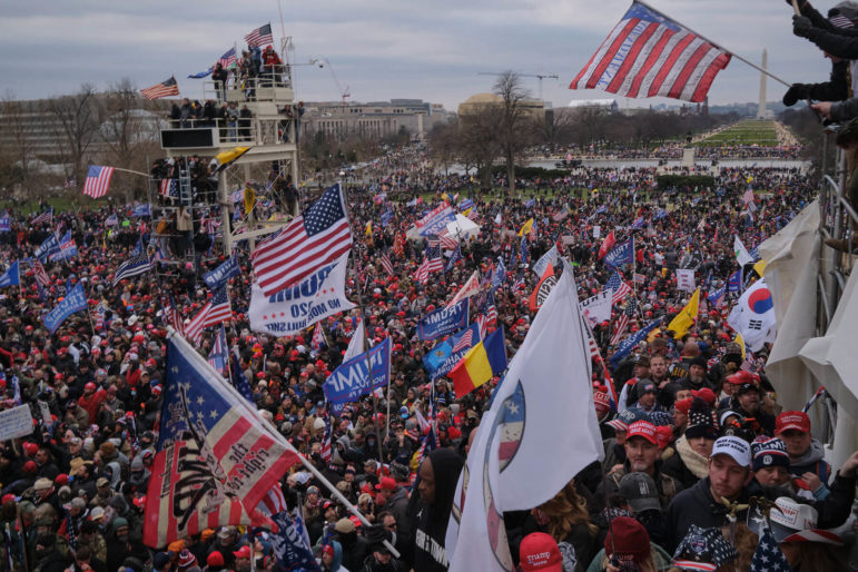 A mob of Trump loyalists fills the West Front of the Capitol grounds as insurrectionists climb and occupy scaffolding set up in advance of President-elect Joe Biden's inauguration. (Quinn Glabicki for PublicSource)